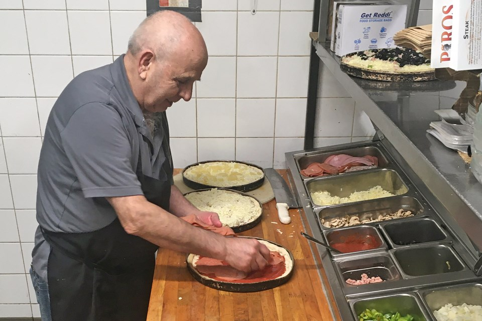 George Mitsuolas, who alongside wife Helen runs Piros Family Restaurant in Sundre, prepares on Wednesday, May 13 an order of complementary pizzas for staff at the Sundre Hospital and Care Centre. Simon Ducatel/MVP Staff
