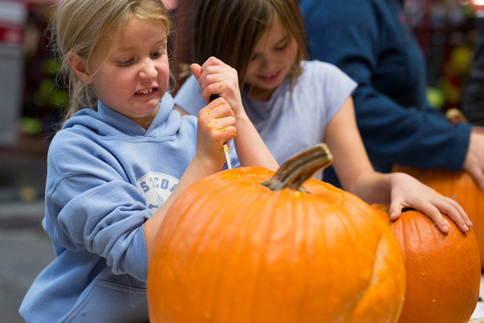 Skylur Robertson carves on Wednesday, Oct. 30 a pumpkin during the Sundre Fire Department's annual family pumpkin carving event at the fire hall. 