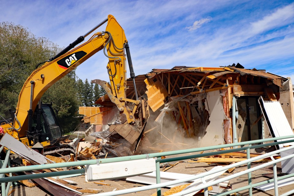 Demolition for the old Autumn Glen Lodge for seniors began in the morning of Aug. 31. The 59-year-old structure, along with adjacent Poplar Grove Court, will be fully demolished by the third week of October to make way for new development. Johnnie Bachusky/MVP Staff
