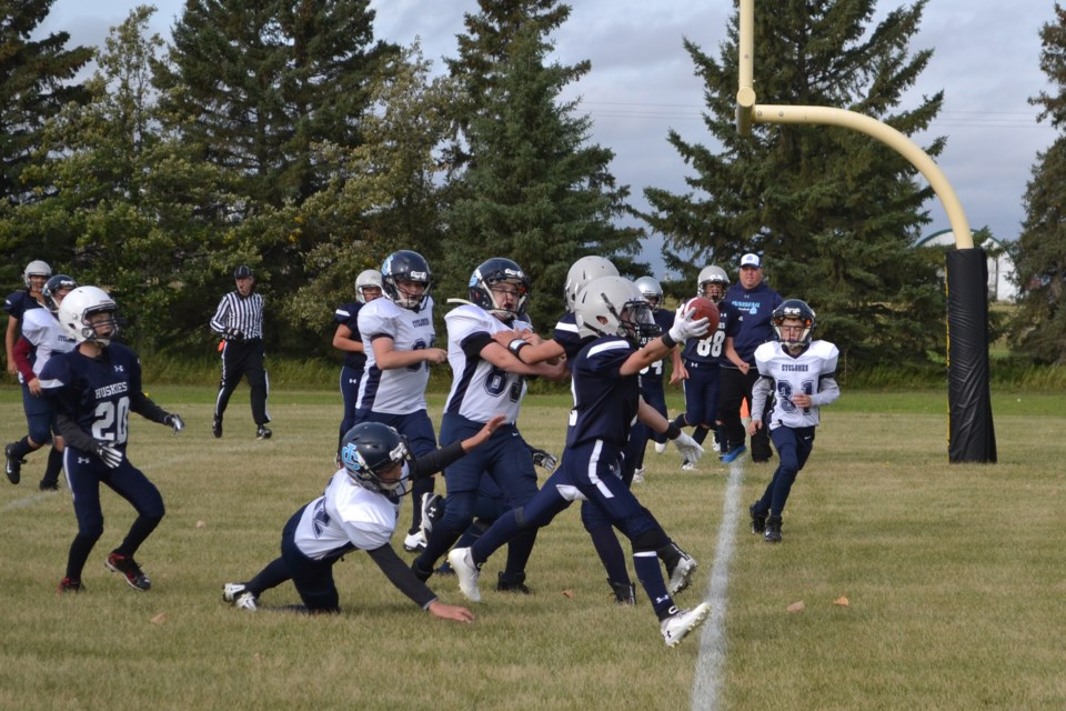 The Innisfail Cyclones were unable to keep Ethan Pedersen (2), of the Olds Huskies, out of the endzone on this play during a peewee football game Sept. 12 at Normie Kwong Field. Doug Collie/MVP Staff