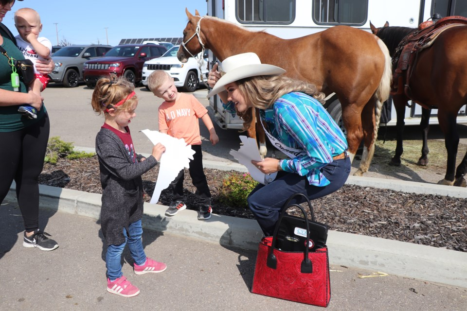 Many children were delighted to meet Alicia Erickson, Miss Rodeo Canada 2020 and 2021, during her visit to town on Sept. 4 where she met and entertained appreciative locals at Innisfail Chrysler. Johnnie Bachusky/MVP Staff