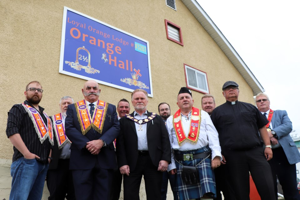 Members of the Innisfail Orange Lodge gather outside their revamped hall during their open house on Sept. 12.  Johnnie Bachusky/MVP Photo