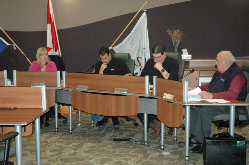 Mayor Annette Clews, left, speaks with councillors Chris Vardas, Tony Jordan and Myron Thompson during last week's special council meeting.