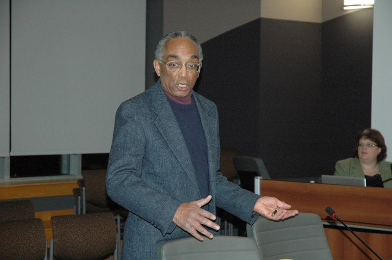Anton Walker, a member of the Sustainable Sundre Committee, speaks with town councillors.
