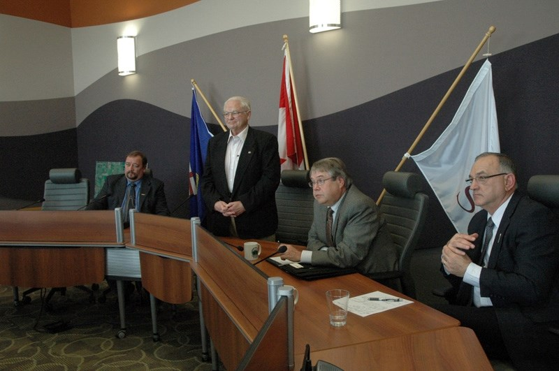 Rocky-Sundre MLA Ty Lund, centre, speaks with guests at last week's government ministers visit to the town office. Ministers Snelgrove, Renner and Gourdreau as seated