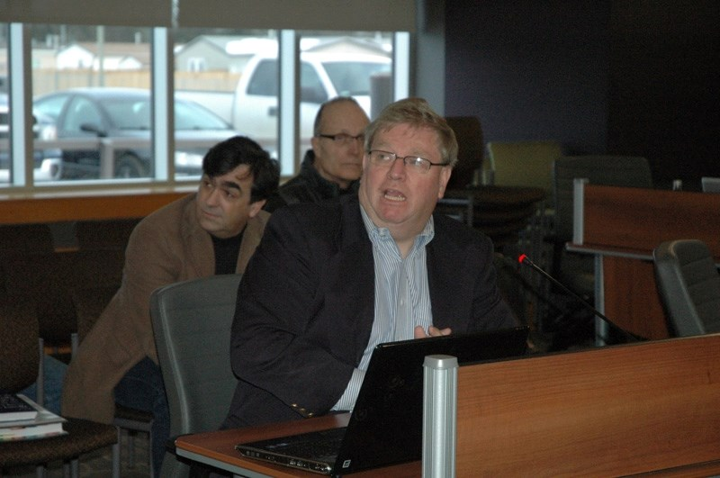 Hunter speaks with town councillors during last week's governance committee meeting.