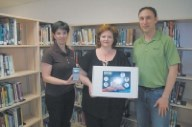 Fortis officials presents donation to library staff