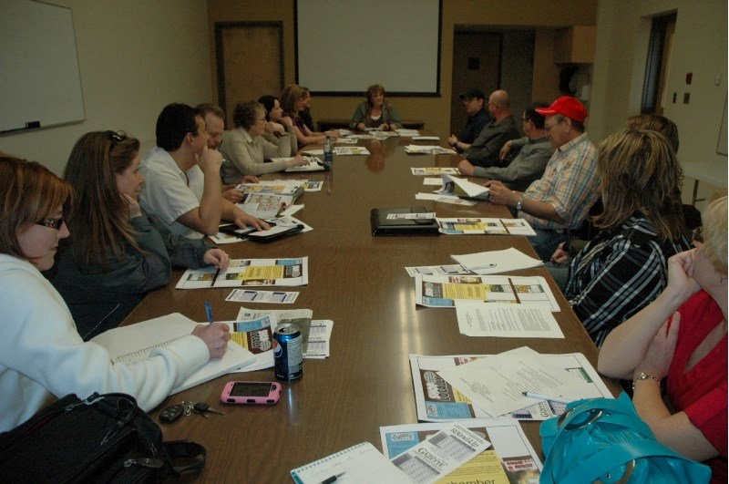 Sundre chamber members discuss town business during last week's monthly meeting at the Sundre Community Centre.