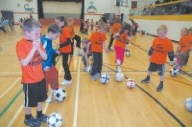 Sundre youngsters practice soccer last week.