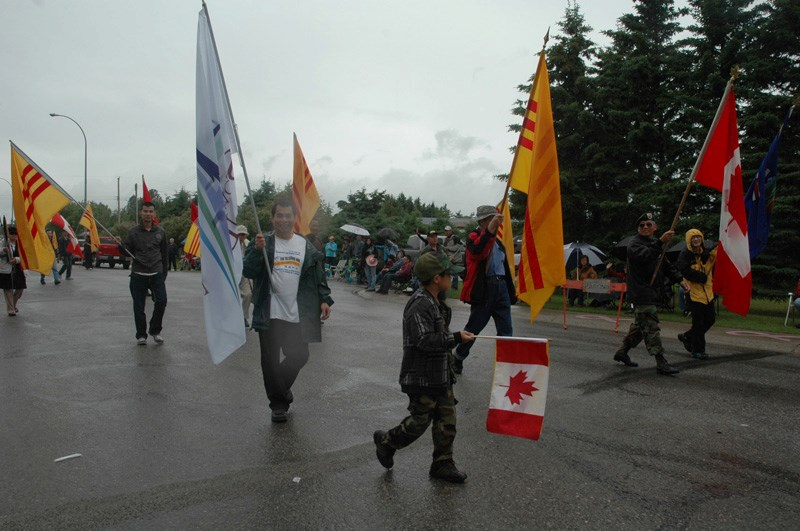 Supporters carry Republic of Vietnam flags during the 2012 Sundre parade.