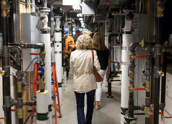People take a tour through the innovative, state-of-the-art facility.