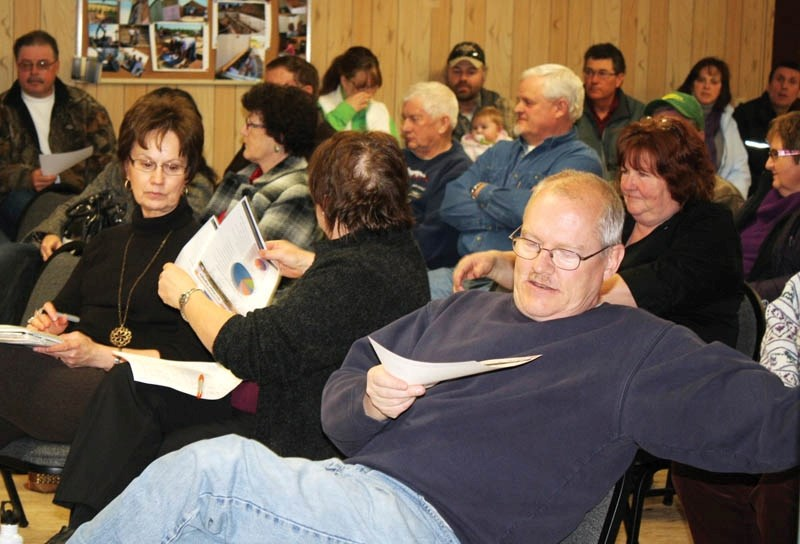 Red Deer County residents peruse literature at last Thursday's town hall.