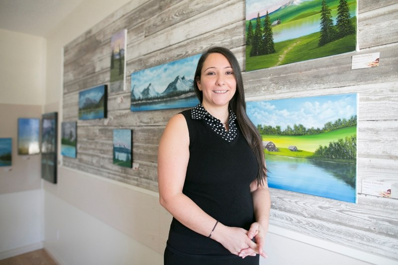Shirin Yamolky with some of her artwork at the Carstairs Heritage Centre on Nov. 24.