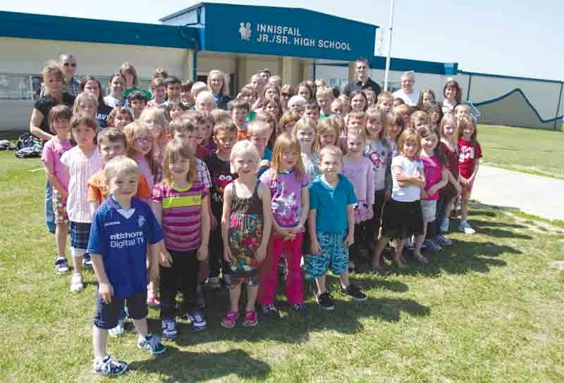 The French Immersion students from école John Wilson Elementary School and Innisfail Middle School stand with their teachers and principals in front of Innisfail Junior