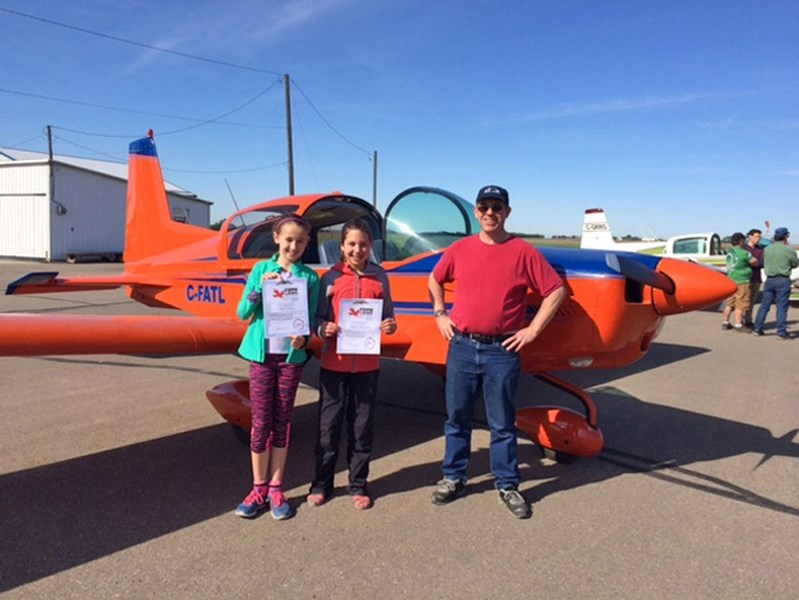 The COPA For Kids flight day is taking place April 29 at the Innisfail Airport. Hope Jacobs and Maisyn Petryshen of Innisfail, pose with their pilot during last year's