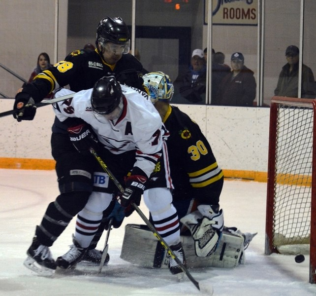 Innisfail Eagles forward Pete Vandermeer battles in front of the net as the puck crosses the goal-line during the last home game of the regular season against the Fort
