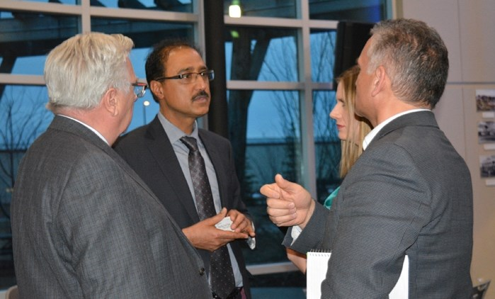 Amarjeet Sohi, minister of infrastructure and communities, left, with Penhold mayor Dennis Cooper at the Mayors' Forum in Red Deer on March 29.