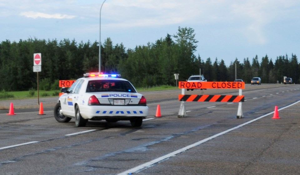 Hwy. 2A south bound was closed Thursday as the investigation of a body found on the side of the road continued.