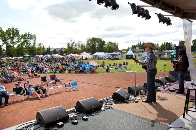 Matt Masters plays a set to a crowd of festival goers at Carstairs Memorial Park last Saturday.