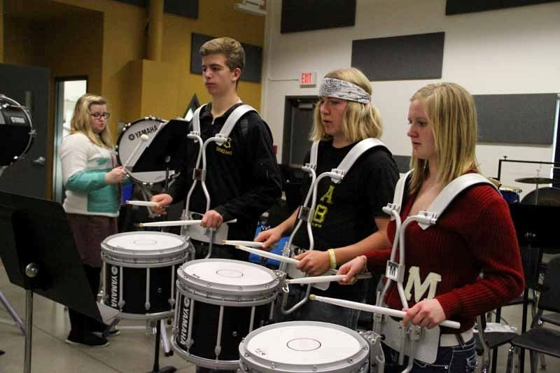 Mary Nielsen, Kevin Spicer, Quade Smith and Courtney Schafer practise drumline once a week at the Fine Arts and Multimedia Centre.