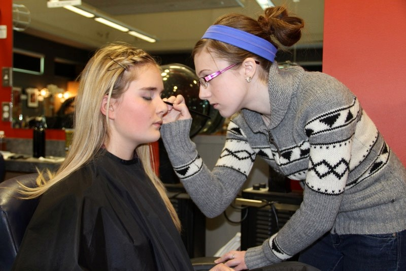 OHS student Kayla Urbanowski benefited from the help of cosmetology student Carly Smith before each performance of Annie Get Your Gun.