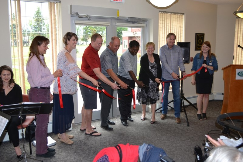 Staff and dignitaries cut the ribbon to officially open Rotary Gardens. From left: Mountain View Seniors' Housing (MVSH) chief financial officer Debra Steiger, MVSH