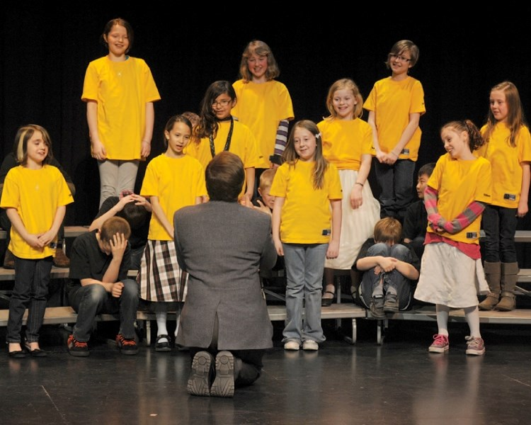 Larry Steed's éOES Grade 4 Choral Speech group performs The Embarassing Episode of Little Miss Muffet during the 29th Annual Olds and District Kiwanis Music Festival