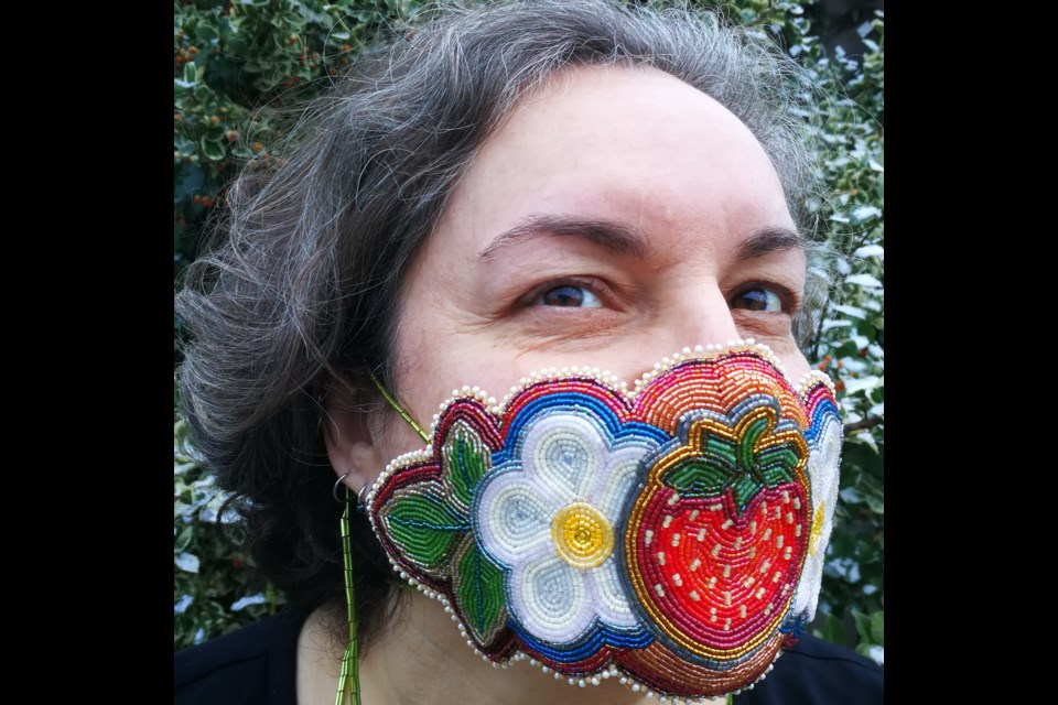 Newmarket artist Nathalie Bertin wears one of the beaded face masks she made as part of the Breath art project she co-founded. Supplied photo/Nathalie Bertin