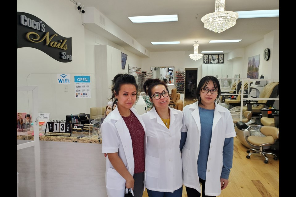 Kesone Kurusumuthu and her daughters, Alexia and Thanh, at Coco's Nails and Spa on Main Street Newmarket.