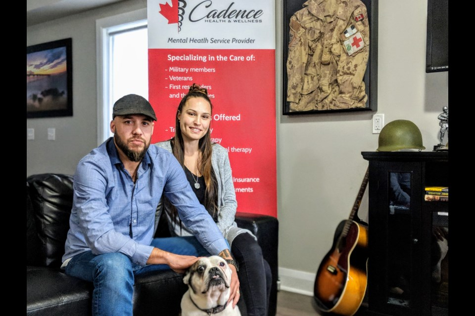 Co-founders of Cadence Health and Wellness, Chris and Angel Dupee, with family pet, Bentley. Kim Champion/NewmarketToday