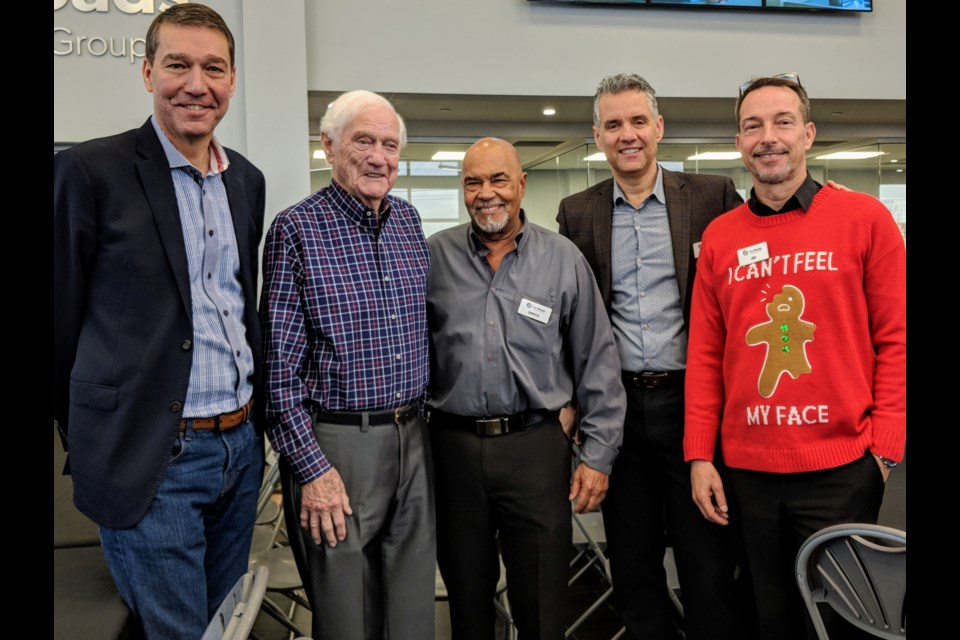 Newmarket Mayor John Taylor, NewRoads Automotive Group's Noel Croxon and business partner Deryck Gilpin, son and CEO Michael Croxon, and chief operating officer Jim Van Dussen celebrate the group's 50-year anniversary Dec. 20. Kim Champion/NewmarketToday