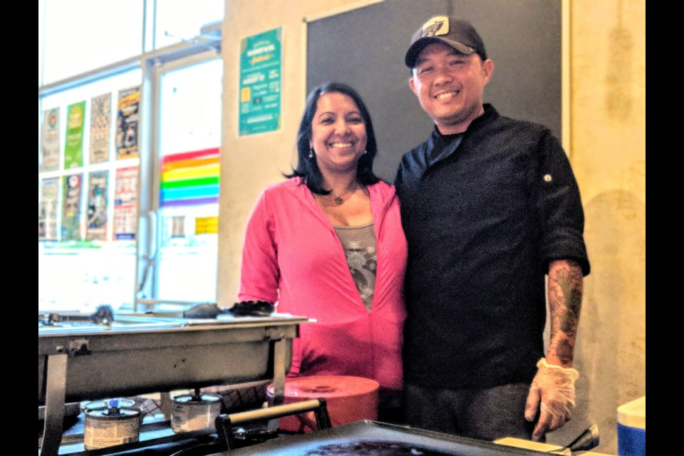 Amphay Sisavang (right) and his wife, Anitra Basant Sisavang, work a pop-up kitchen Tuesday nights at Market Brewing Company. Kim Champion/NewmarketToday