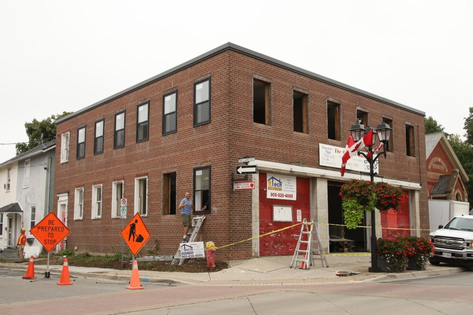 The Old Fire Hall at 140 Main St. S. gets new windows put in on Sept. 10, 2020. Greg King for NewmarketToday
