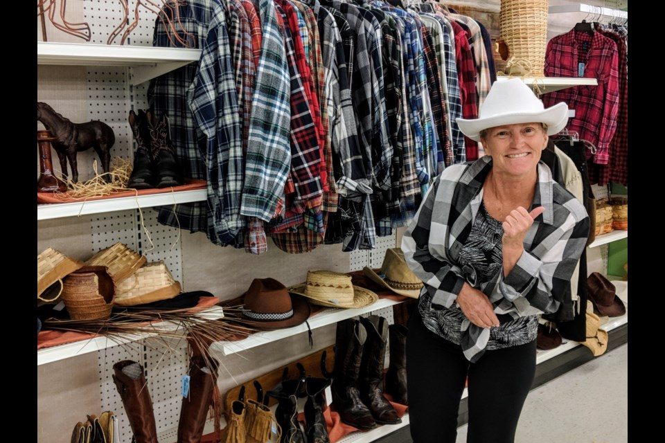 Mission Thrift Store volunteer  Diane Mitchell manages the country clothing and accessories section at the Yonge Street shop in Newmarket. Kim Champion/NewmarketToday