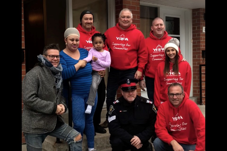 York Regional Police Association members are shown here with recipients of the Random Acts of Christmas program in 2018. Supplied photo/YRPA