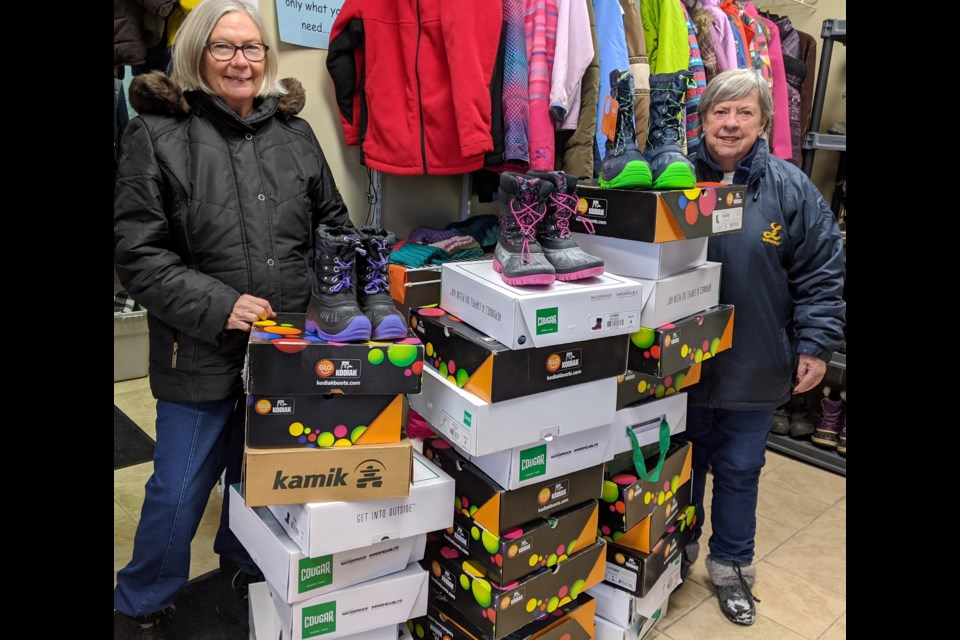 North Newmarket Lions club member Leah Springford (left) and Newmarket Lioness Rosie Tozer are shown here with the 32 pairs of boots purchased with a $1,000 grant from the Awesome Foundation. Supplied photo/Facebook