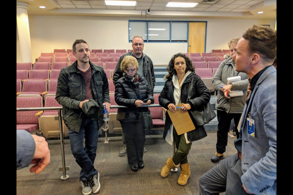 A group of residents share concerns about Airbnb-type short-term rentals at a Dec. 10 public meeting. Kim Champion/NewmarketToday