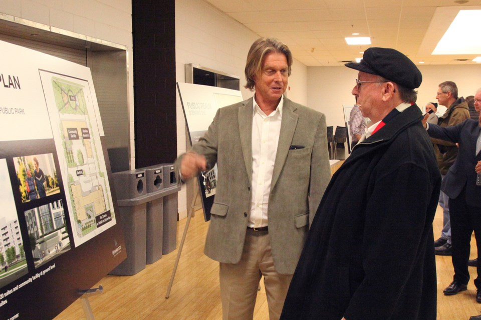 Briarwood Development Group head of highrise development, Hugh Magennis, explains a detail to Terry Alderson at the developer-led community meeting in February 2019.  Greg King for NewmarketToday