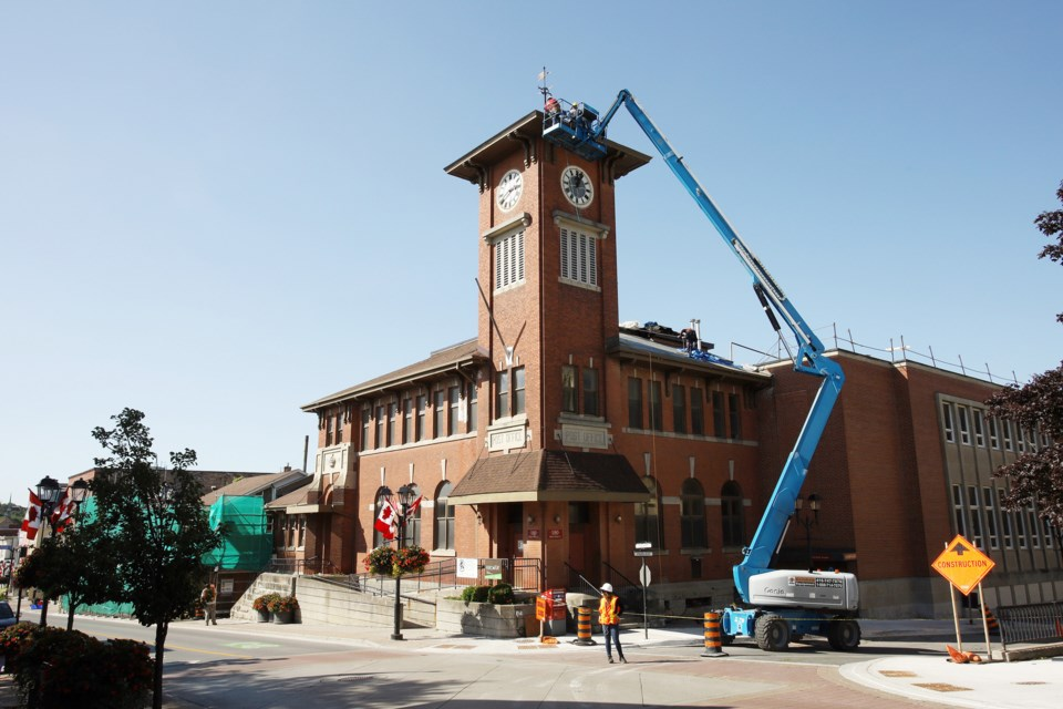 Roofers began their work on the historic Clock Tower this week. Greg King for NewmarketToday