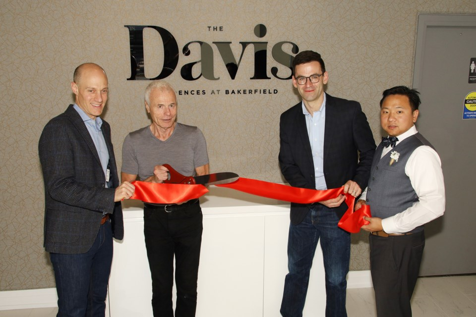 Rose Corporation's Daniel Berholz, (from left) Sam Reisman, Andrew Webster, and Brian Shew officially open the Davis Residences at Bakerfield sales office yesterday.  Greg King for NewmarketToday