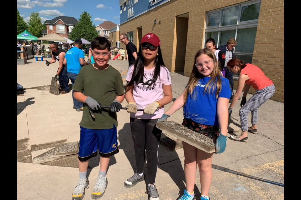 St. John Chrysostom CES students Carlo Cioffi, Arian Juanico and Alexis Totten get down to work. Debora Kelly/NewmarketToday