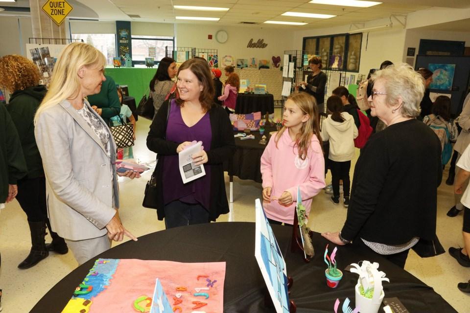 Councillor Christina Bisanz (from left) speaks with parent Lynn Demchuk, Lauren Demchuk and Janet Duffy at St. Nicholas Catholic Elementary School's 25th anniversary celebration May 6.  Greg King for NewmarketToday