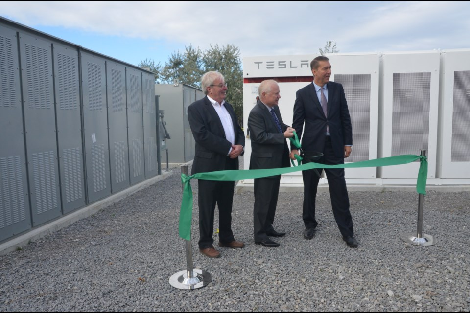 Ameresco Canada president Bob McCullough (centre) is joined by Newmarket Mayor John Taylor (right) and Paul Ferguson, president of Newmarket-Tay Power Distribution on Sept. 24 for the grand opening of the Newmarket battery energy storage facility on Twinney Drive. Supplied photo/Ameresco Canada