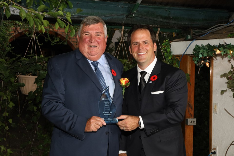 Bradford Councillor Peter Ferragino accepts a Healthy Land Award on behalf of Nick and Ted Mendrek.  Greg King for NewmarketToday