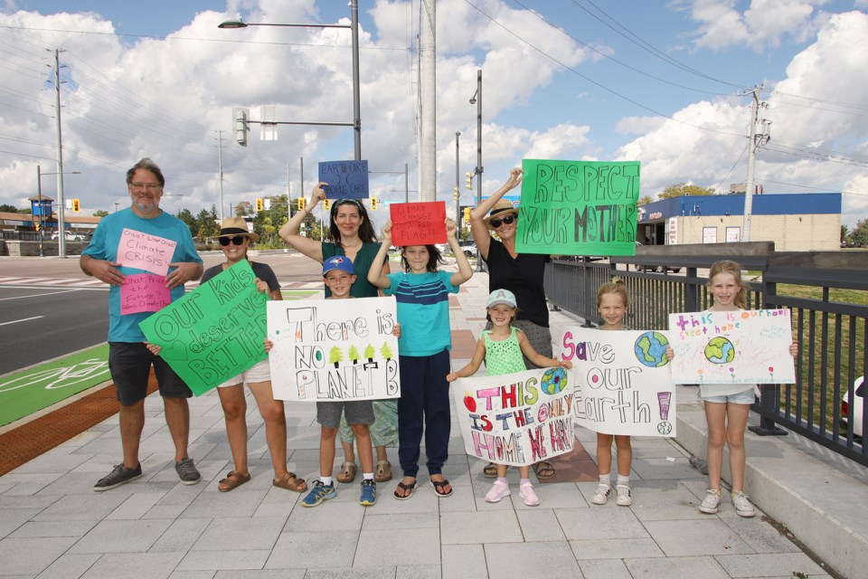 For the Sept. 8 National Day of Action against climate change, Russ Coles, Holly Douglas, Mollie Coles-Tonn, and Ashley Arkeveld brought their kids and grand-kids because is their future.  Greg King for NewmarketToday