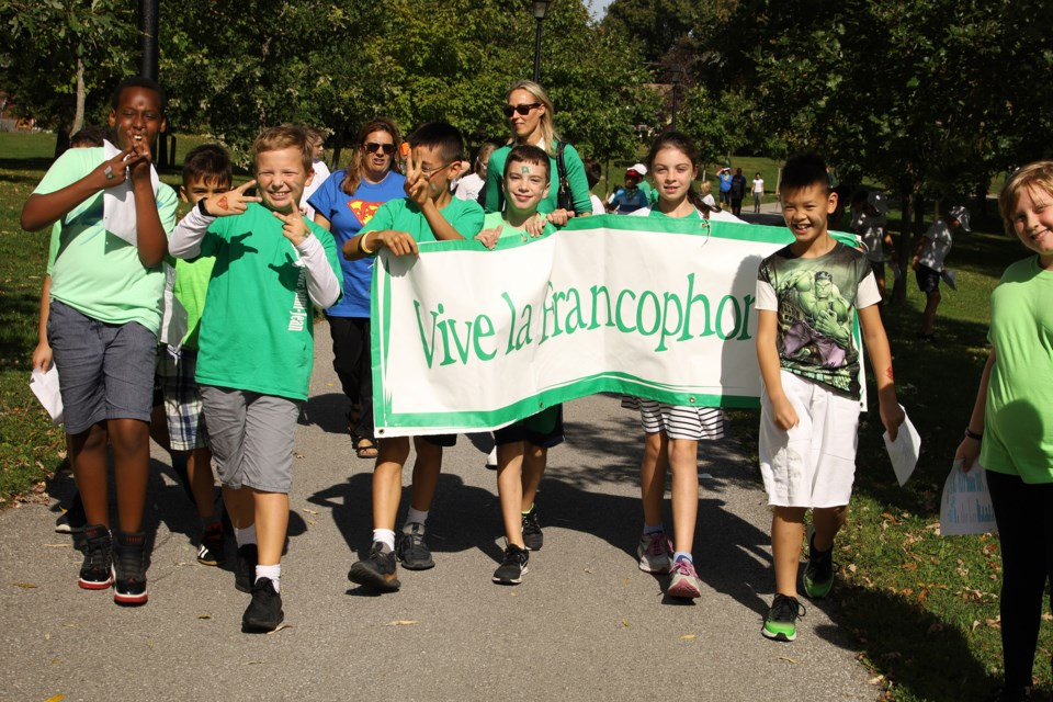 Mazo de La Roche Public School  students carry their banner on the Tom Taylor Trail on Franco-Ontarian Day today.  Greg King for NewmarketToday