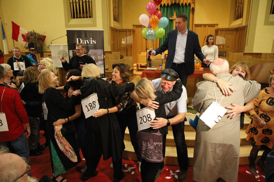 More than 4,000 hugs helped Newmarket smash the Guinness world record yesterday for the most hugs by a team of eight in 60 minutes at Trinity United Church. Greg King for NewmarketToday