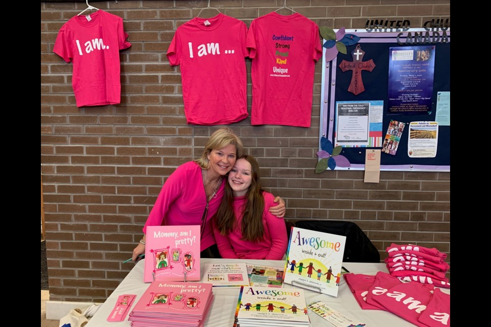 Author Margot L. Denomme and daughter Brooke at the CFUW Aurora/Newmarket's International Women's Day event in Newmarket March 6. Debora Kelly/NewmarketToday