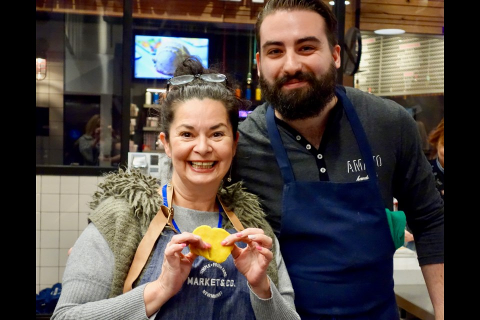 NewmarketToday reporter Kim Champion proudly displays her hand-made pasta with Amano Kitchen chef and co-owner Michael Angeloni. Debora Kelly/NewmarketToday