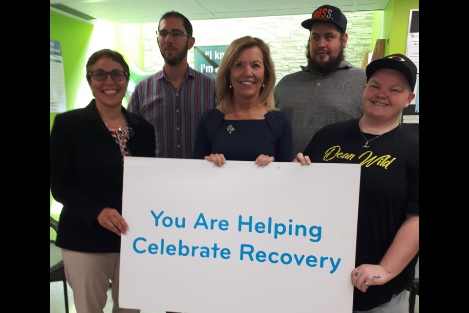 CMHA York Region and South Simcoe CEO Rebecca Shields (left) and Deputy Premier and Health Minister Christine Elliott and clients mark Recovery Month. Supplied photo/CMHA York Region and South Simcoe